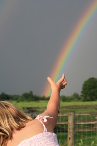 girl reach rainbow